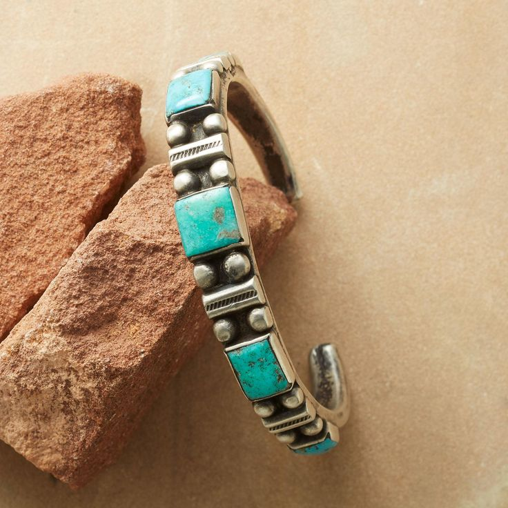 """FOX INGOT CUFF--Arizona silversmith Jock Favour is particularly fond of working with coin silver ingots, obtained from melting down pre-1965 American and Mexican coins, using traditional Navajo tufa-casting techniques to forge jewelry of timeless strength and beauty. His narrow, antiqued cuff shows off blue and green turquoise from Nevada's Fox mine, accented by beadballs and stamped motifs. One-of-a-kind cuff bracelet, made in USA. Exclusive. 2-3/8"""" dia. 3/8"""" tapers to 1/4""""W."""