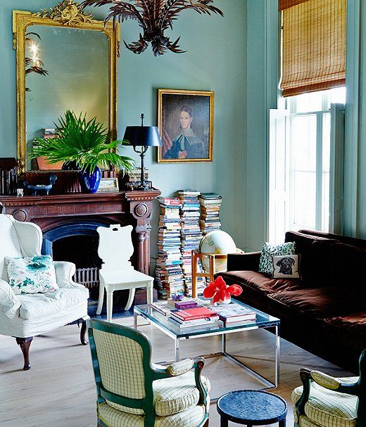 blue interiors,  19th-century manse, New Orleans, ,  14-feet-tall ceilings, Pair bronze, copper, or gold  with blue walls, chrome coffee table, velvet sofa  Gossamer Blue from Benjamin Moore.