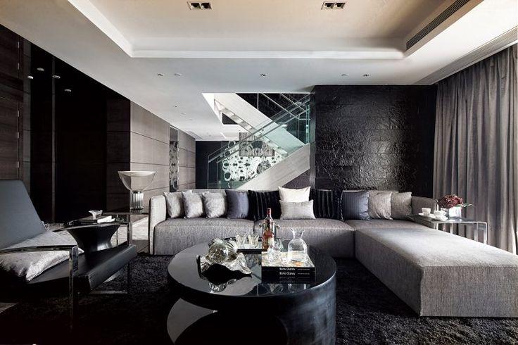 peinture noire, escalier droit avec main courante, canapé d'angle gris taupe et table basse noir laqué