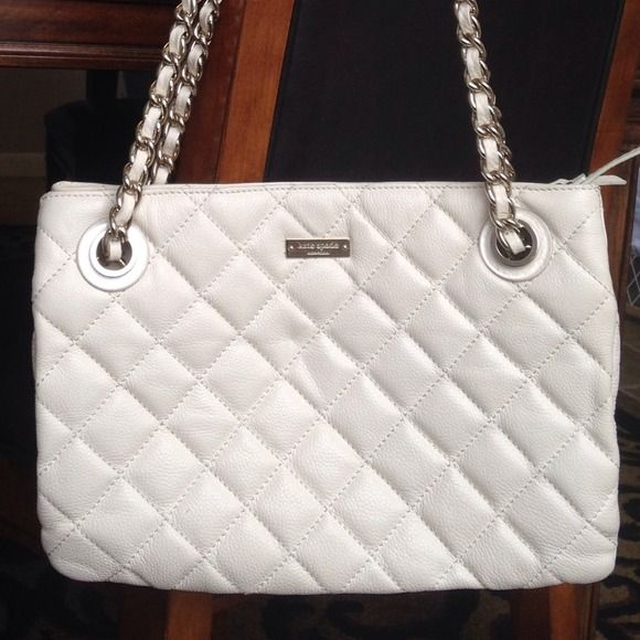 Kate spade maryanne gold coast ivory purse For sale is a Kate Spade gold coast purse in the Maryanne style. very few markings inside. The outside only shows minor wear on the each of the corners and on some of the leather in the chain strap detail. This is approximately 12 to 13 inches long and about 9 inches high.  Well taken care of.   Please me know if you have any other questions and be sure to check my closet for more to bundle. kate spade Bags