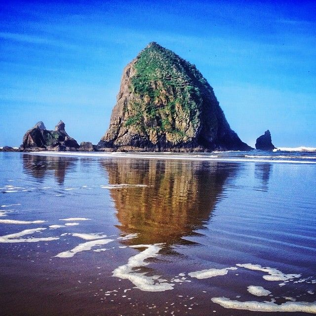 Majestic Haystack Rock on Cannon Beach, #Oregon. Photo courtesy of ravenreviews on Instagram.