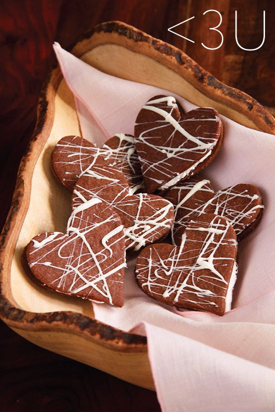 Heart-shaped chocolate sandwich cookies filled with white chocolate ganache are perfectly tasty little treats for the one you love.