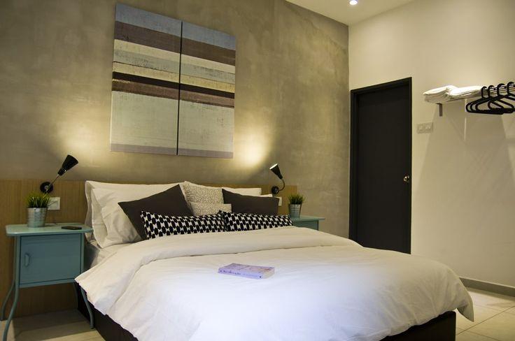 Indsutrial styled master bedroom interior design.