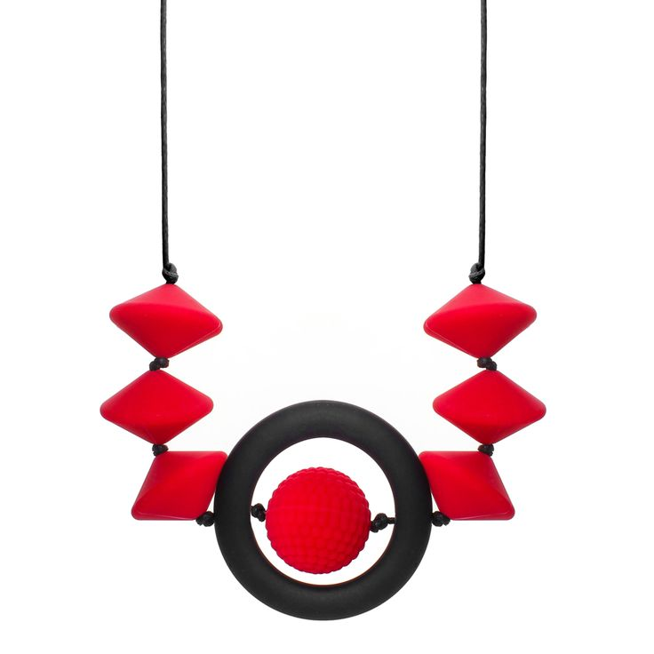 Classy combination of red and black with a silky soft matt feel. Visual and tactile, two ingrediants for the perfect teething and breastfeeding necklace. Add to that, striking colours, soft texture and a bundle of style... introducing the Infinity collection!  The UFO and bumpy beads are 28mm diameter.  The infinity ring has a 60mm outside diameter.  30cm drop with a custom, breakaway, safety clasp.  BPA, lead, latex, phthalate free silicone jewellery.