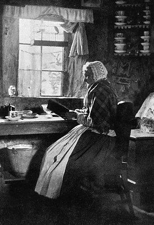 Inspiration. Old photograph of a Crofter reading in her cottage on Isle of Skye, Scotland.
