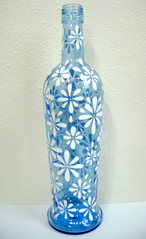 This beautiful vase makes a great center piece or adds beauty to any room. I hand painted it with enamel acrylic paint making it safe to hand wash. The vase can hold fresh cut flowers, fake flowers, or stand on it's own.