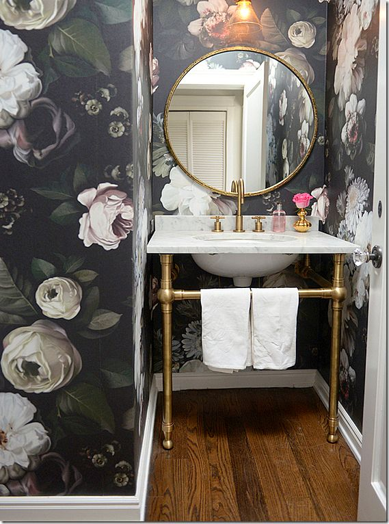 LOVE the overscaled floral wallcovering in the small powder room!
