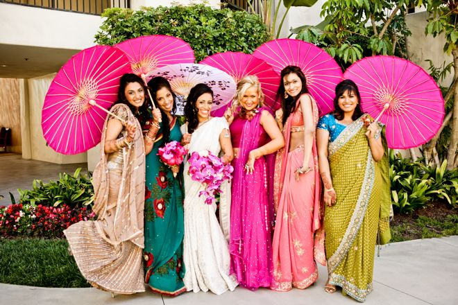 gorgeous mismatched saris & hot pink parasols for the bridesmaids at this Indian wedding in California http://su.pr/2lYe61