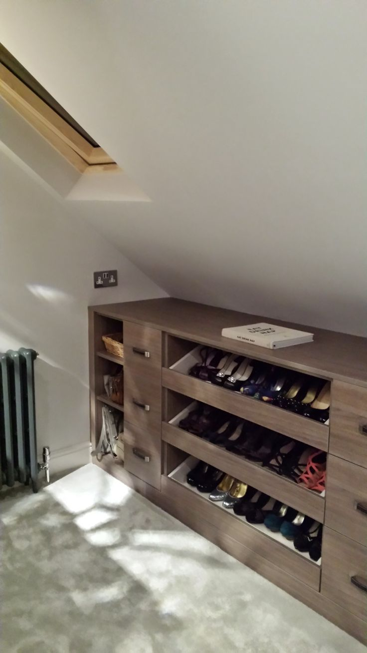 Emma Victoria ID- 2014 Loft conversion project - Bespoke eaved dressing room storage with pull out shoe drawers.