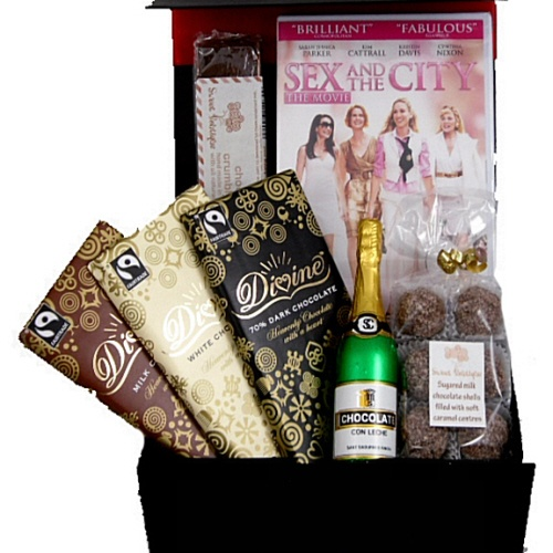 """This mouth-watering """"chocolate girl"""" gift box hamper comes filled with luxury and quality delicious and delectable chocolate indulgences. Includes chocolate bars, fudge and truffles. Teamed with a great chick flick movie (7 to choose from) this makes a perfect gift on many occasions"""
