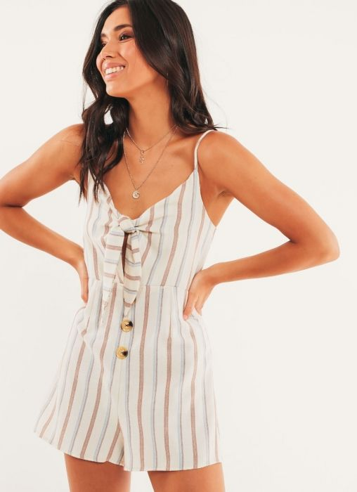 This sugar-sweet playsuit is perfect for your every move… - Beige striped playsuit - Fitted style - Tie-front detail - Contrast tortoiseshell buttons - Adjustable straps - High-waisted shorts fit - Invisible back zip - 65% Cotton, 35% Polyester Complete the look with slides to keep it casual. Shop the latest playsuits online at Peppermayo.