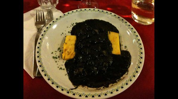 The deep black color of this dish -- polenta and cuttlefish -- is derived from the ink of the cuttlefish. Adding to the must try list!: Black Colors, Food And Drink, Photo