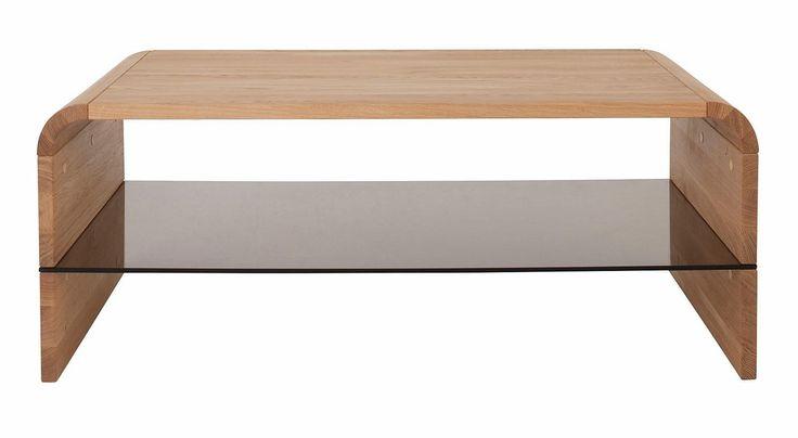 Der Couchtisch aus FSC® zertifiziertem Massivholz ist im extravaganten Design gehalten. Der sehr hochwertig verarbeitete Tisch hat durchgehende Lamellen, das Holz ist geölt und strahlt dadurch eine besondere Wärme aus. Die Ablageplatte aus Glas bietet Ihnen zusätzlichen Stauraum, Maße (B/T): 105/66 cm. Außenmaße (B/T/H): 110/60/43 cm Details: In 2 Farben, 2,5 cm starke Tischplatte, Tischplat...