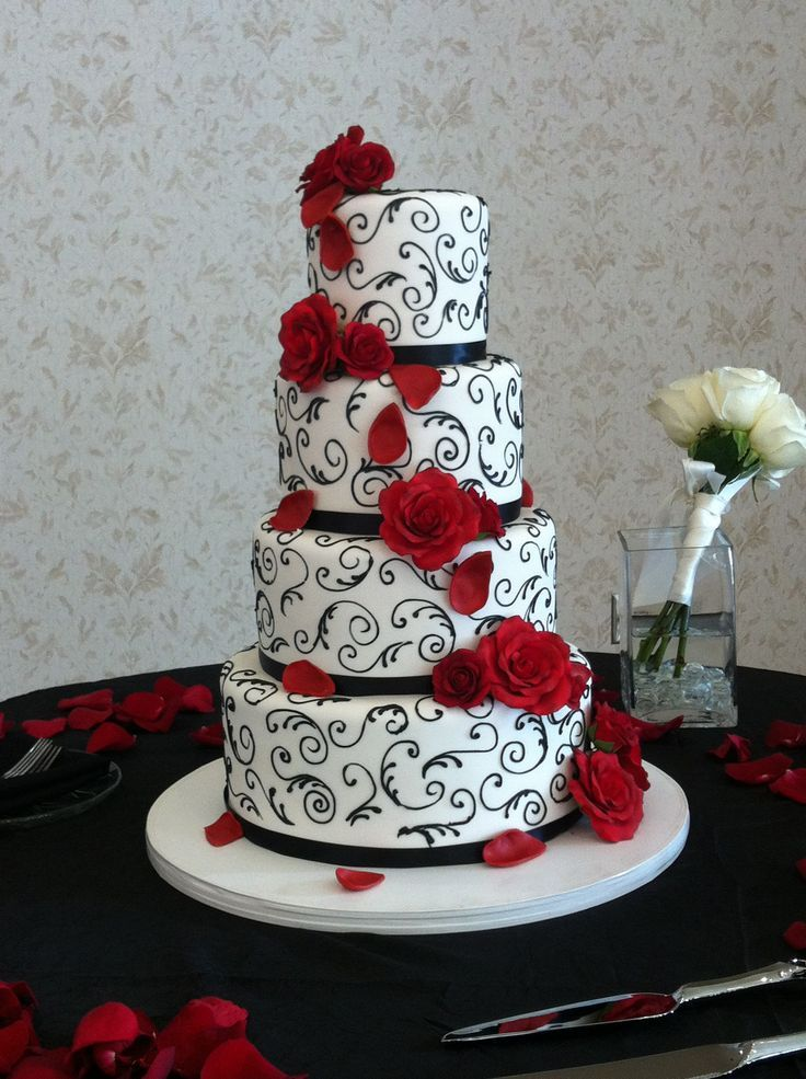 Elegant red, black and white wedding cake. Event and photo by www.annachristineevents.com Cake by It's Tasty Too More