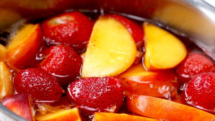 STRAWBERRY PEACH SANGRIA Serves 8-10 INGREDIENTS 15 strawberries 2 peaches 2 cups water 1½ cups sugar 1 bottle white wine, chilled ¾ cup rum Extra strawberri...