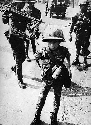 """Robert Capa, Vietnam, 1954    On May 25, [Cappa] accompanied a French convoy whose mission was to evacuate two indefensible outposts in the Red River delta. While the convoy was halted at one point, Capa wandered with a detachment of soldiers into a field beside the road.     He stepped on a landmine, and was killed with his camera in his hand. """"This war is like an actress who is getting old. It is less and less photogenic and more and more dangerous"""", Capa had said before."""