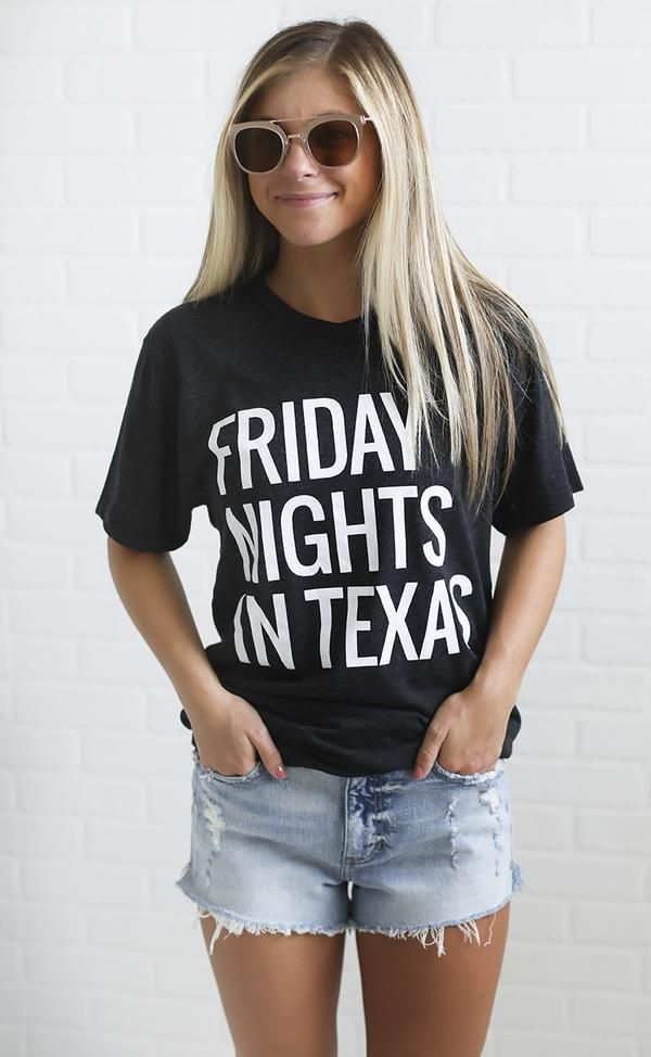 You can't beat a Friday night in Texas! This t shirt features a charcoal fabric with white lettering.   model is wearing a size small fits true to size hand was