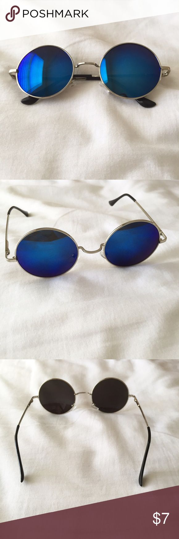 Blue Sunglasses Round blue reflective sunglasses. Color might slightly differ due to lighting. Accessories Sunglasses