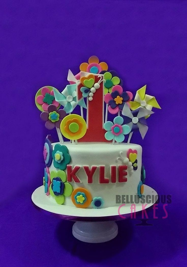 Bright and shine themed cake by Belluscious Cakes
