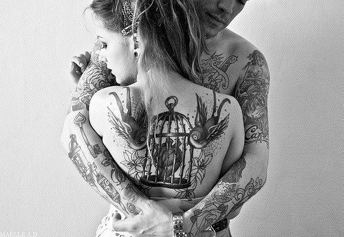 Tattooed couple :) love the cage.