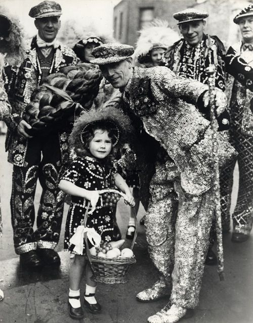 A group of 'Pearlies' from the 1900s. In the 19th century London was full of street traders known as costermongers or costers. In order to attract customers costers would decorate their clothes with mother of pearl buttons which were a common product manufactured in the East End of London. In the 1870s an orphaned road sweeper and rat catcher called Henry Croft took inspiration from this, covered a suit and top hat with pearl buttons and used the notoriety it gave him to raise money for…