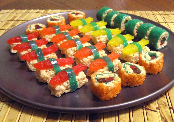 Candy sushi made with Rice Krispie treats, Swedish fish, fruit by the foot and Twizzlers