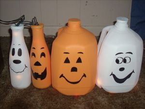 halloween ghost and pumpkin light decorations from recycled milk jugs and bottles