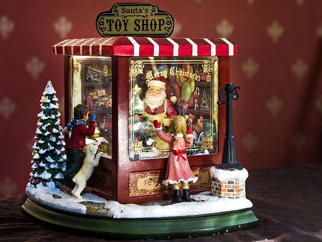 Julestemning. Kunstner Unni Askeland mener denne spilledåsen er akkurat som den perfekte amerikanske jul. Hun har den stående fremme hele året. VG+- Foto: FRODE HANSEN
