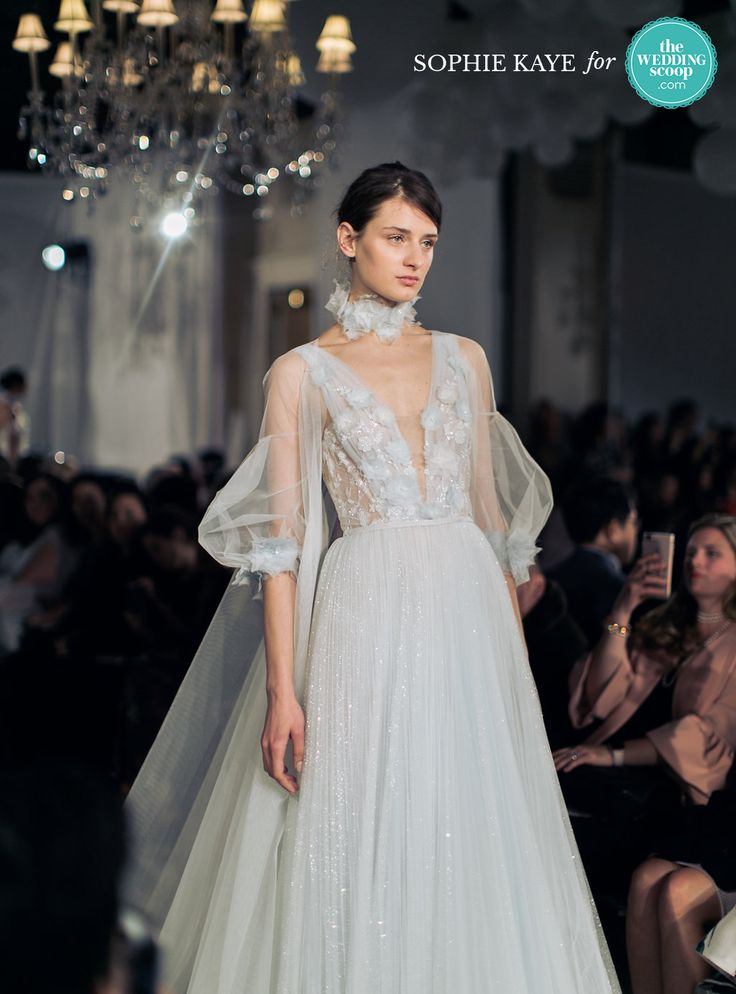 Mira Zwillinger Studio showcasing see-through puffy sleeves with beautiful tulle skirt with embroidery // Hand-cut floral appliqué with Swarovski crystals, feather trim, sequins and whimsical sheer balloon sleeves at Mira Zwillinger Studio Bridal Spring 2018   // : Sophie Kaye Photography for The Wedding Scoop