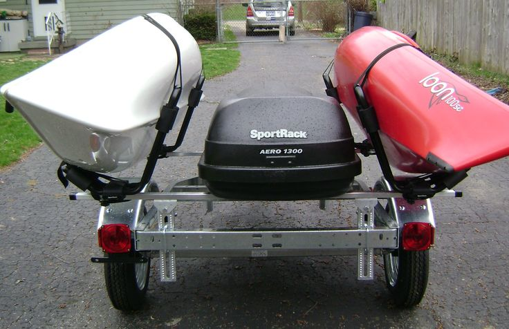 My Hurricane and Old Town kayaks on the trailer I put together by myself.