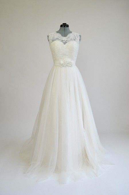 Ivory sleeveless lace wedding dress with tulle skirts. From Tulip Bridal in Sammamish, WA. Used to be less han $400, looks like they raised it to $700.