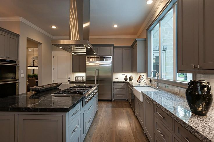"""Thermador stainless steel appliance package. Double ovens, warming drawer, built-in subzero refrigerator/freezer, 48"""" 6 ring gass burner range with griddle, stainless steel vent hood. Sparkle white granite countertops. Jet Myste granite island."""