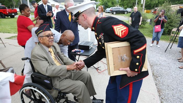 Sergeant Mike Stachowski greets Archibald Mosley, May 27, at the Colp Area Veterans Celebration, Dedication and Remembrance Ceremony, in Colp, Illinois. The ceremony honored fallen service members, Mosley and three other African American Marines from Colp, who were among the first black Americans to join Marine Corps during World War II. They became known as the Montford Point Marines. Nearly 20,000 African-Americans joined the Marine Corps in 1942, after President Franklin D. Roosevelt…