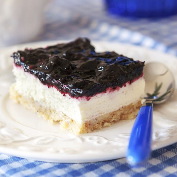 A Yummy blueberry cheesecake bars recipe, this makes a delicious dessert to enjoy with company or family.. Blueberry Cheesecake Bars Recipe from Grandmothers Kitchen.