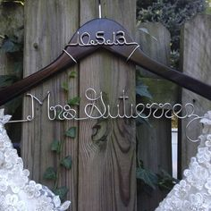 A custom bride hanger is the perfect way to show off your gorgeous gown in your wedding photos! Made using a sturdy wooden hanger with carved notches to help prevent slippage of your delicate garments