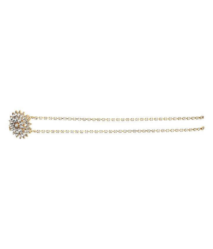 Gull. Et hårbånd av doble metallkjeder med strass. Det har en dekorativ blomst av fasettslipte glasstener. Elastikk bak.