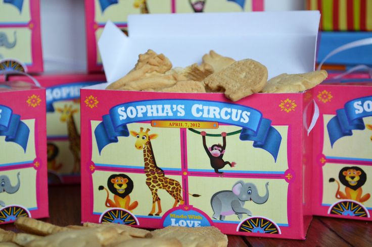 Personalized Pink Animal Cracker Boxes for by 6elmdesigns on Etsy.  They also have a personalized box in red if that color would be better.
