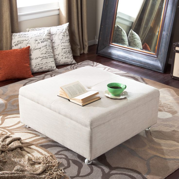 Corbett linen coffee table storage ottoman there is for Where to put ottoman