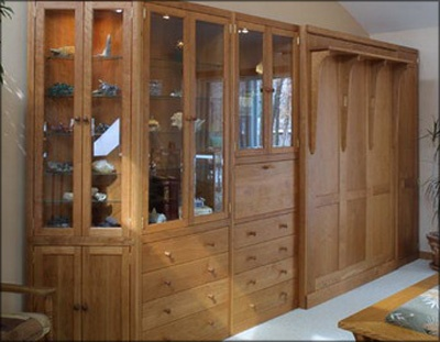 Hardwood Artisans murphy bed with wall units and corner unit in