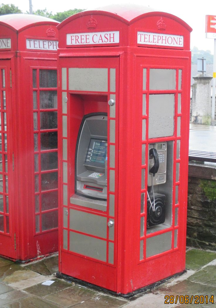 A K6 phone box rebuilt as a cash machine and phone point, photographed in June 2014 in Lancaster Square, Conwy town, Conwy.