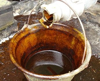 sugar beet molasses in bucket