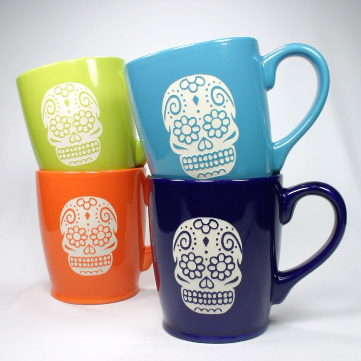 Celebrate the Day of the Dead with this fancy sugar skull mug! This large, sturdy coffee mug comes in tangerine orange, navy blue, sky blue or celery green. Large ceramic coffee mugs - - dishwasher-sa