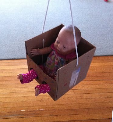Pretend doll swing from a cardboard box, love the idea of a diy cardboard doll area... beds, this swing...