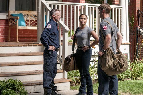 David Eigenberg, Jesse Spencer, and Monica Raymund in Chicago Fire (2012)