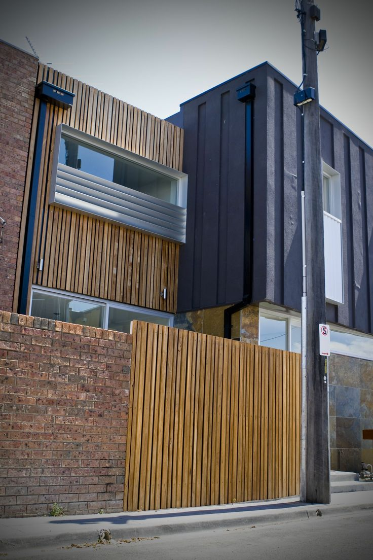 This project incorporates Radial Timber Beveled Edge Screenboards 75x22 and 55x22 for the facade and front fence. See more: http://radialtimbers.com.au/portfolio-type/south-melbourne/