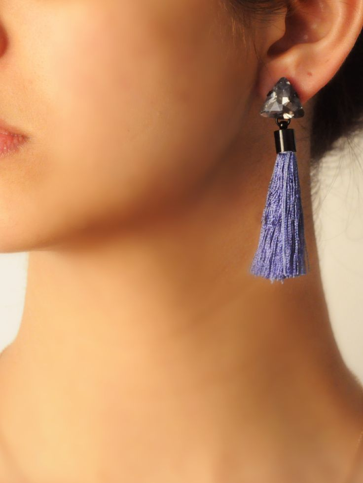 Menorca Tassel Drops -  INR 1,199 -  These tassel earrings feature a pale shade of Denim Blue which works well with your everyday wardrobe. The triangular smoked crystal on top gives it a hint of glimmer. #locolatte #earring #tassel