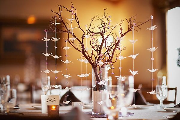 another centerpiece option that would still look adorable with the burlap and mason jar theme would be a manzanita style branch with paper cranes...cheaper than flowers for every table too