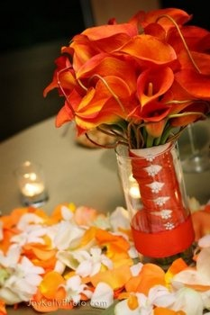 Wedding, Bouquet, Orange, Bridal, Flowers by atalanta.  Like how it's in a vase so it's not just laying in the table....