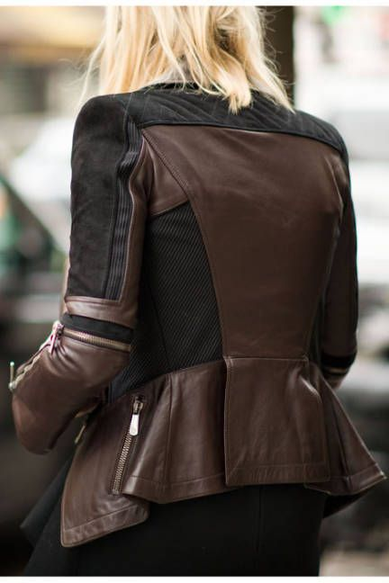 A leather jacket boasts elaborate detail and flair