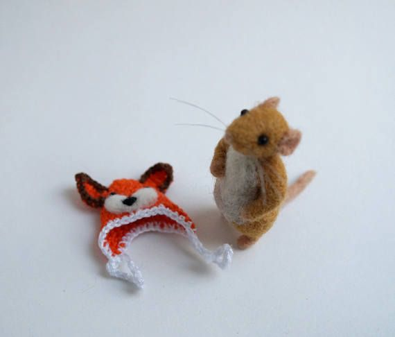 Brown mouse in a fox hat